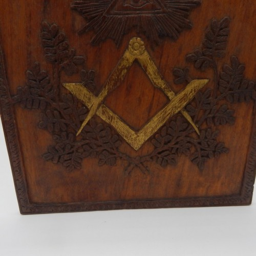 wooden hand extended panel with compass and square. with gold paint