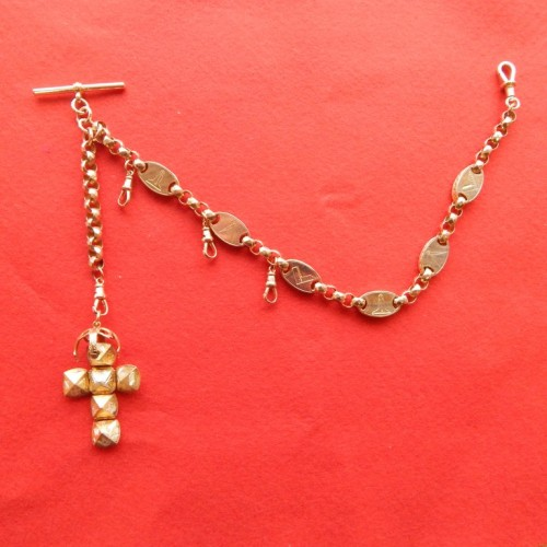 antique gold watch chain with maconic symbols with large ball charm.